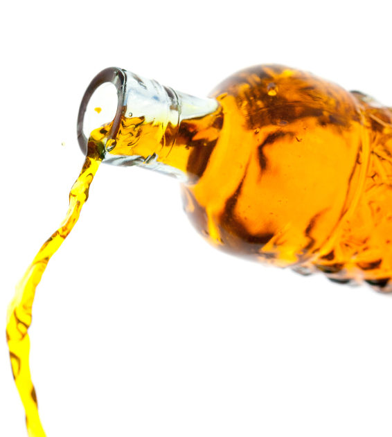 Amber liquid - could be oil or alcohol pouring out of an upended bottle.